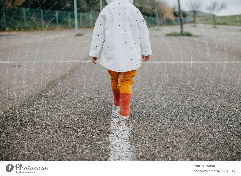 Rear view child walking with red rubber boots Child 1 - 3 years Authentic Red Rubber boots Playing Joy Day Human being Infancy Colour photo Exterior shot