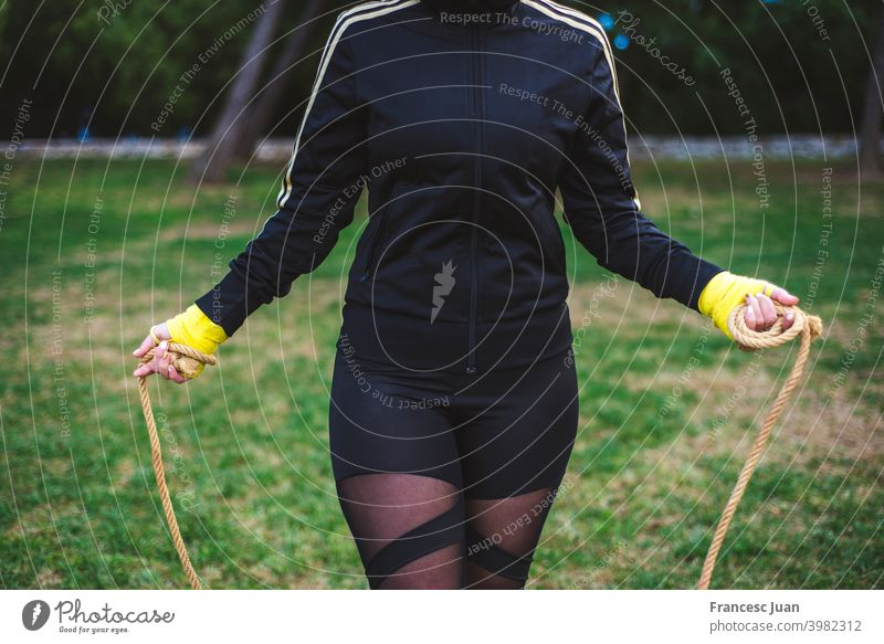 Outdoor shot of determined woman skipping outdoors in nature. beautiful exercise fitness girl happy healthy park training wellness active athlete athletic