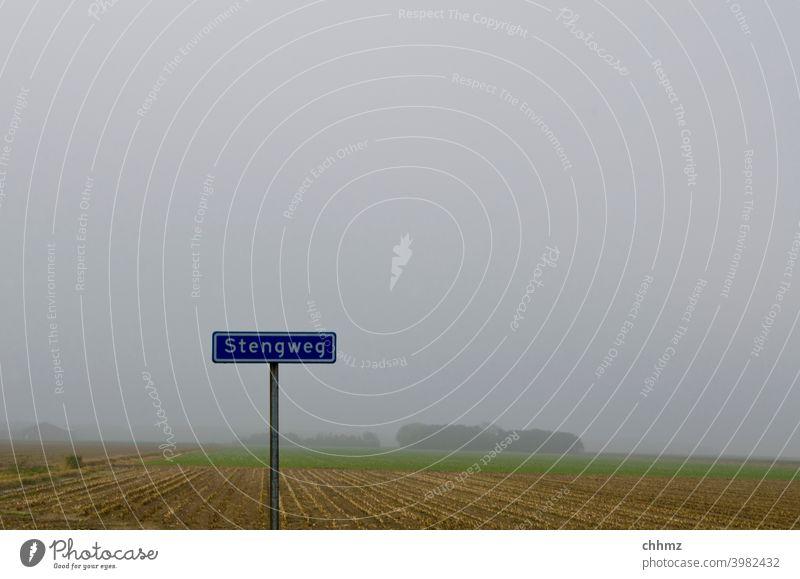 Stengweg Signs and labeling sign street sign Texel Letters (alphabet) Fog Gray Landscape Deserted Flat Plain Exterior shot Horizon Signage Word Dutch