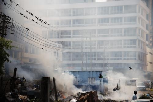 a lot of smoke due to waste incineration in the city Environmental pollution Refuse incineration Mombasa Kenya Smoke Authentic Downtown Facade