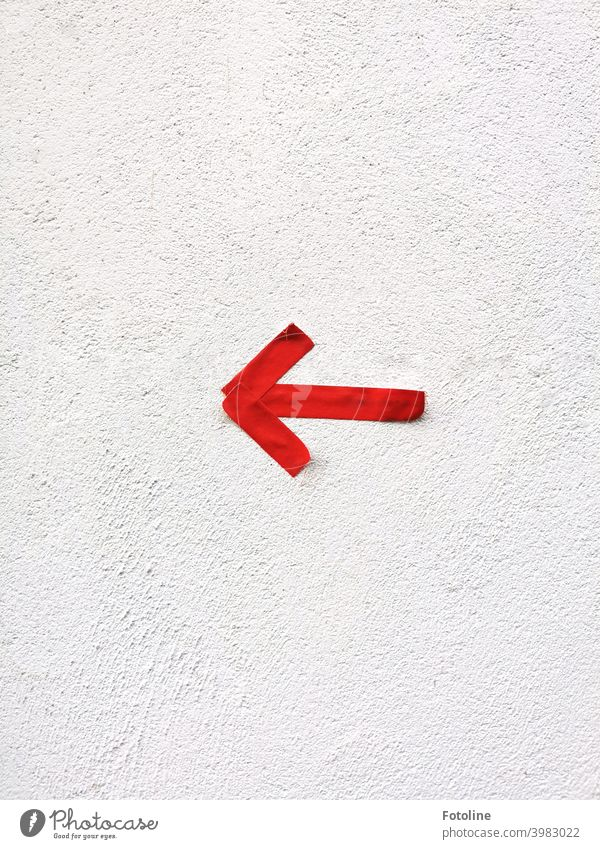 To the left! At least that's what the red arrow says. Arrow Direction Trend-setting Target Orientation Deserted Sign Signs and labeling Colour photo Signage