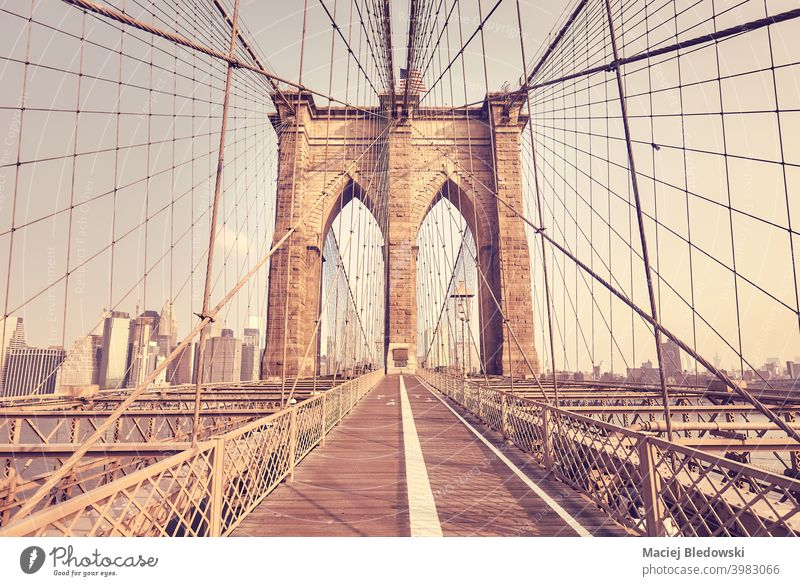 Retro color toned picture of Brooklyn Bridge, New York City, US. city landmark travel architecture retro vintage bridge path effect filtered day USA NYC photo