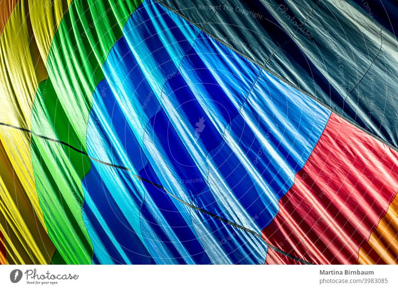 Colorful outside of a deflating hot air balloon rainbow circle colors center centered symmetry fabric hotair fun colorful ballooning background fly