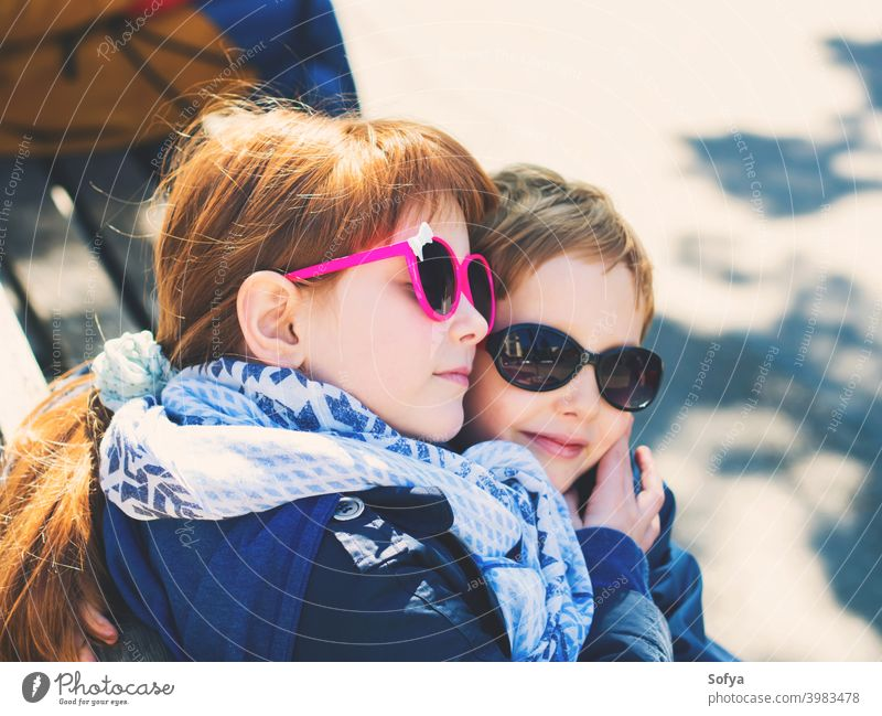 Two cute kids, siblings hugging outdoors child boy together valentine day love friends childhood girl brother caucasian fun sister little people background