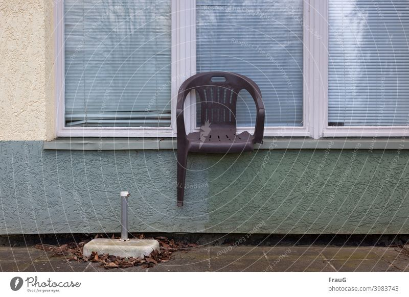 a broken chair on the windowsill House (Residential Structure) Rendered facade Facade Window blinds reflection Chair Garden chair stacking chair Plastic