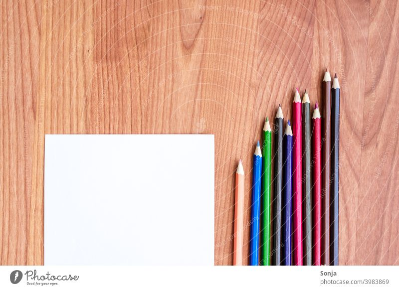 Crayons and a blank sheet of paper on a wooden table crayons Paper Empty Creativity Stationery Colour photo Piece of paper Draw Leisure and hobbies