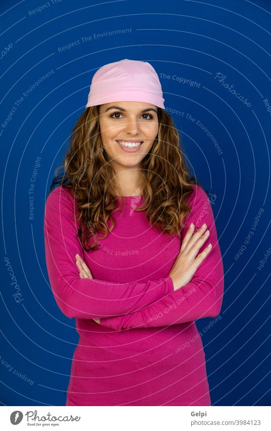 Hopeful woman wearing a pink scarf disease cancer relaxed female happy patient breast health awareness survivor care confidence smiling strong recovery fighter