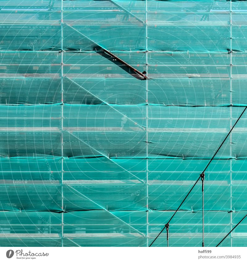 green safety net in front of a scaffolded facade Green Net Construction site Scaffolding scaffold tarpaulin Facade Structures and shapes Redecorate