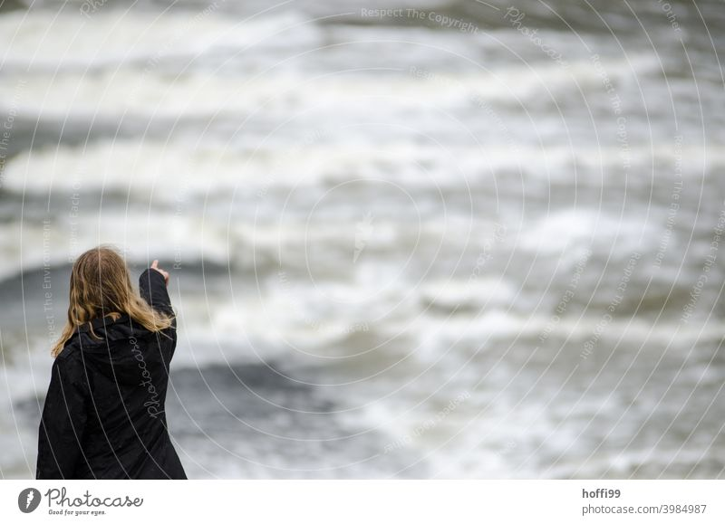 the woman points into the void of the tide, where will it go .... storm tide Climate change uncertainty Ocean Gale Sky Water Environment Wind Flood Weather