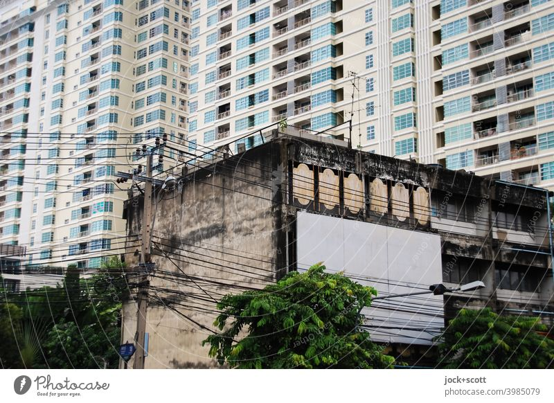 architectural change in the city Facade Bangkok Tower block Thailand Town house (City: Block of flats) Ravages of time Change Past Modern architecture