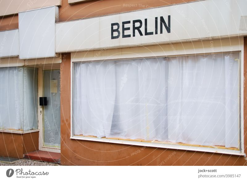 secluded shop through white curtains with the inscription Berlin Berlin-Wedding Store premises Storefront overcast Front door discreet Folds opaque Lettering