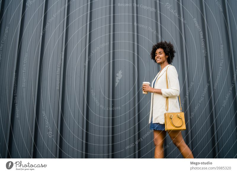 Portrait of afro business woman walking outdoors. urban smile adult coffee take away coffee suit company businesspeople executive portrait standing success one