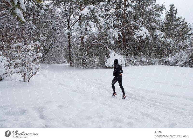 A man jogs through the snow in winter Snow Jogging Walking Sports Winter Man Fitness Movement Athletic Park Nature Snowscape Runner workout Jogger