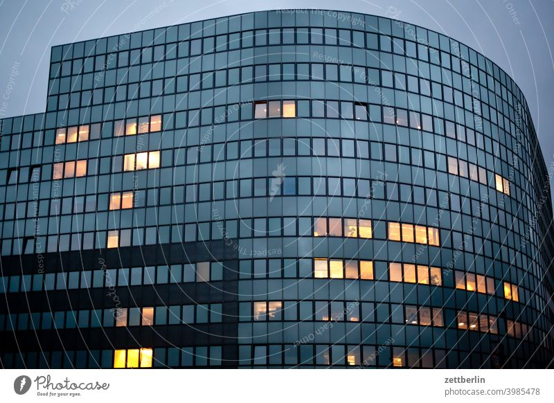 Facade with single illuminated windows Structural engineering Evening Architecture construction industry Construction site Berlin Office city Germany Twilight