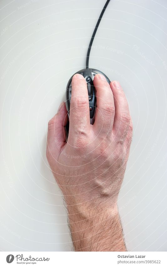 Male hand holding a computer mouse isolated on white top view male man fingers network surfing user design scroll arm concept people digital electronic wheel
