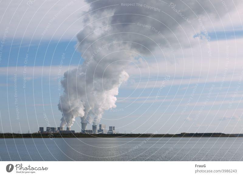 Cloud maker power plant with smoking chimneys Lake Lakeside power station Coal power station Lignite Electricity generating station Smoke Chimney Smokestacks