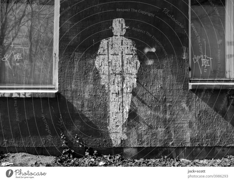 Figure of a person replaced by a plaster facade shape Posture Street art Subculture Lifestyle Style Creativity Silhouette Hat Wall (building) Imprint