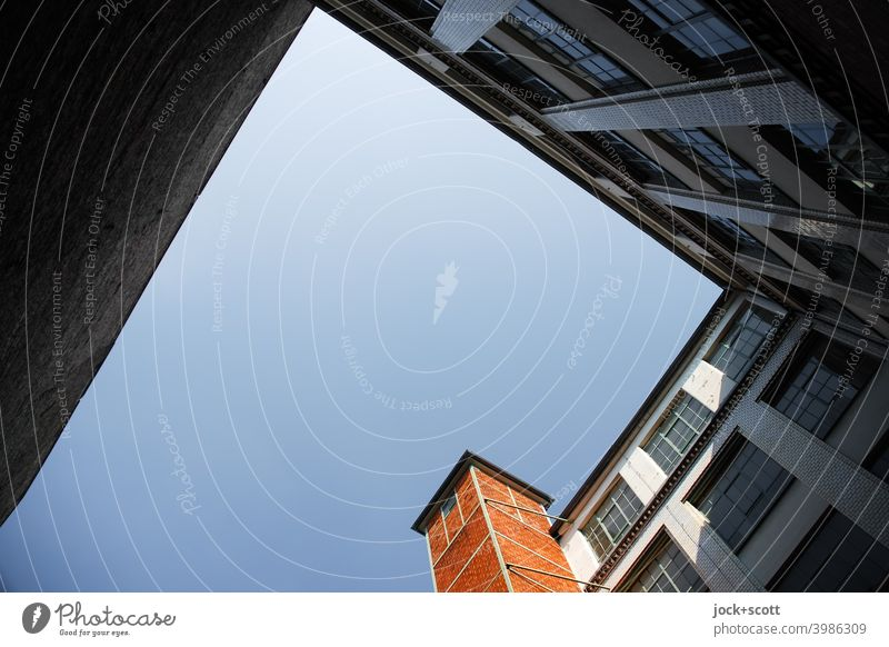 Backyard of commercial building on a cloudless day Commerce Building Facade Architecture Kreuzberg Berlin Cloudless sky Sharp-edged Worm's-eye view