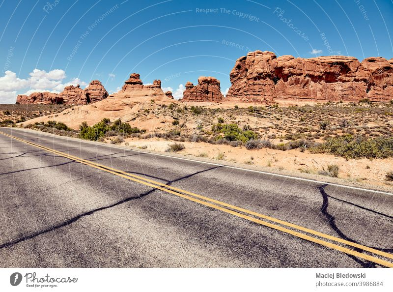 Road in Arches National Park, color toning applied, Utah, USA. America wanderlust road highway travel journey trip adventure deserted road trip freedom drive