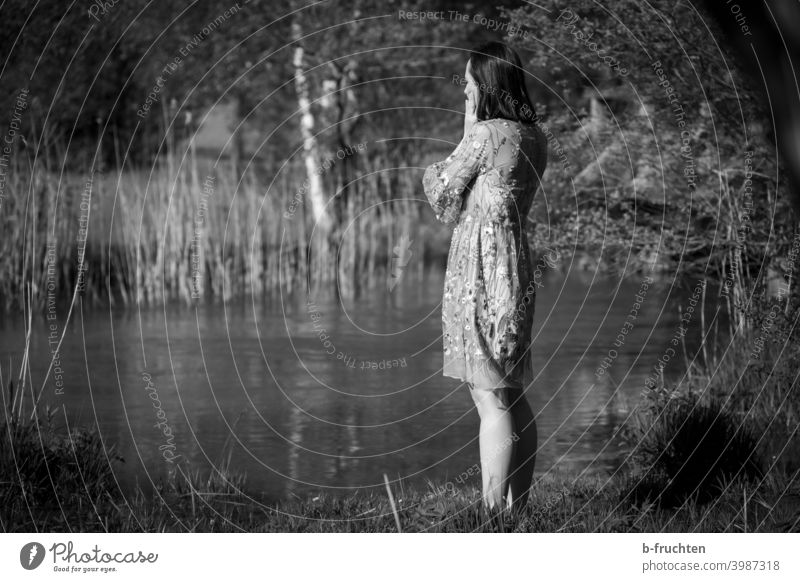 Woman in summer dress standing by the stream ponder Black & white photo Brook Body of water Think Face Looking Thought Grief Calm Hand Sadness waiting Wait Fear