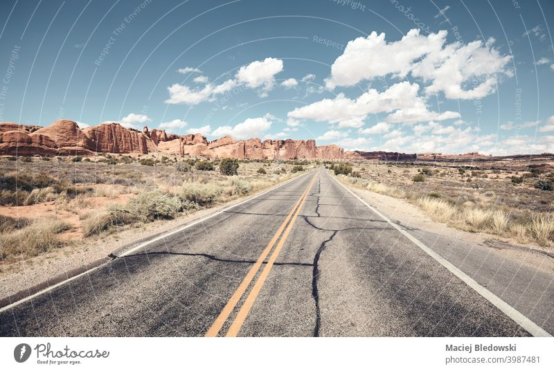 Road in Arches National Park, color toning applied, Utah, US. America wanderlust road highway travel journey trip road trip freedom drive asphalt adventure