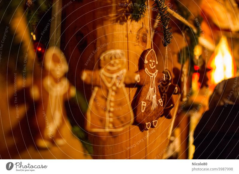 Gingerbread on wooden wall gingerbread Wood wooden beams Cozy Warm light christmas time fir branches Decoration christmas decoration crafted Home-made