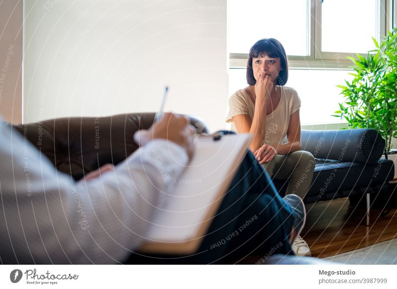 Psychologist taking notes during therapy session. psychologist professional patient mental health counseling therapist psychotherapy psychology doctor