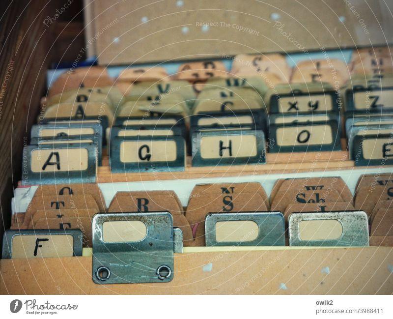 for the sake of good order rough notebook System paperboard Plastic bureaucracy sort Letters (alphabet) Arrangement alphabetical order Alphabetical Colour photo