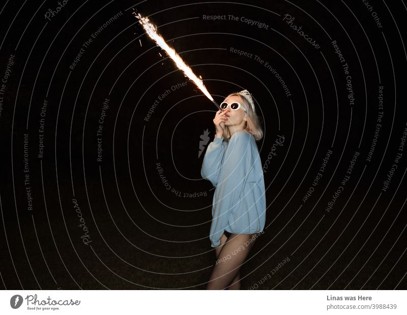 It's Friday night and I feel all right. The party is here on the West side. Blonde girl is blowing fire and having some good times. fireworks pretty legs