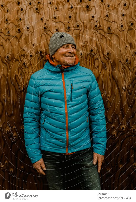 Portrait of a sporty pensioner Athletic Pensioners Man fortunate Facial hair Cap Jacket outtdoor Cool relaxed annuity Retirement Contentment Winter chill