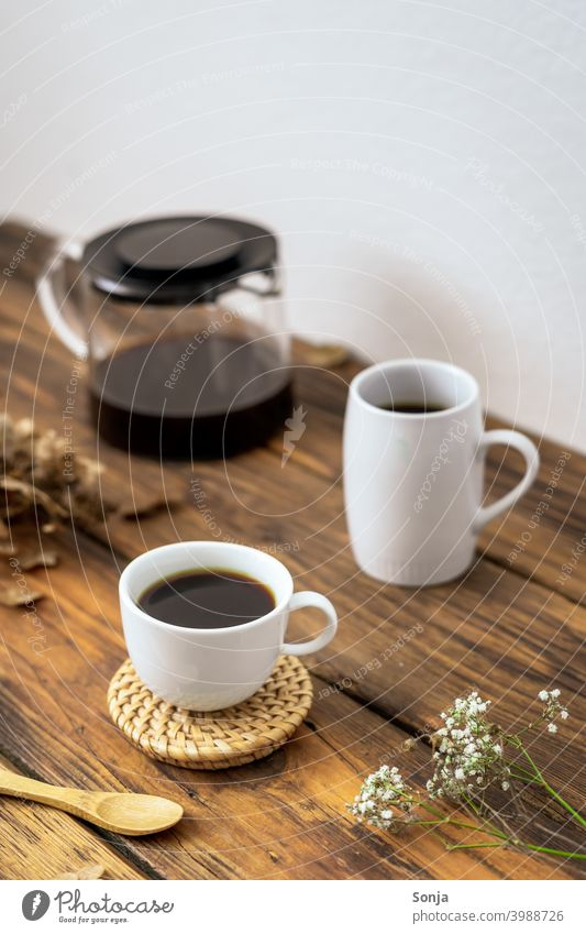 A set coffee table on a rustic wooden table Coffee Coffee break Coffee pot Espresso Wooden table Cup White Beverage Rustic Breakfast Drinking Caffeine Aromatic