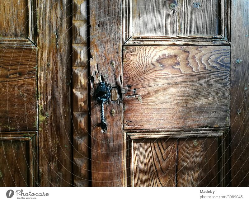Noble wooden door of a beautiful old wardrobe in a country house in summer sunshine in Alacati near Izmir on the Aegean Sea in Turkey Cupboard Closet Wood