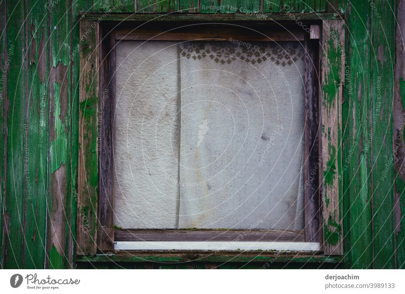 Old window with drawn curtains, which are slightly dirty, with small dark border. The outer frame is dark to light green. Curtain Deserted Colour photo Window