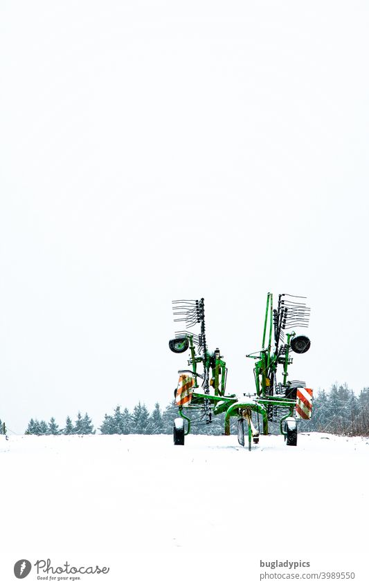Winter boredom - rake stands lonely in the snow windrower Agriculture Agricultural machine arable land Tractor Landscape Work and employment Machinery Vehicle