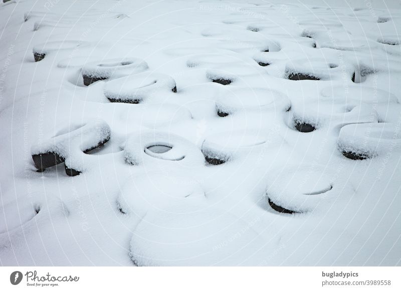Almost everything looks beautiful in the snow Car tire Tire Wheels Rubber Circle Circular Round Snow snow-covered White Soft Black black-and-white Pattern