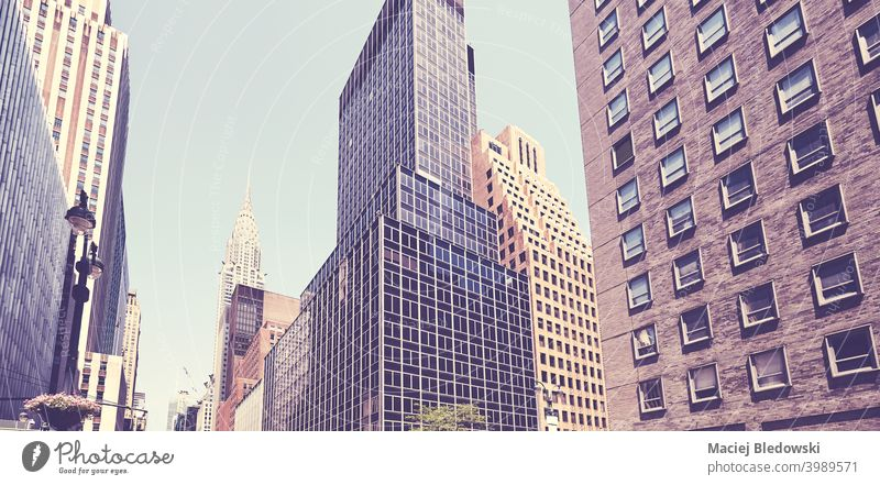 Retro stylized picture of old and modern New York City architecture, USA. city building skyscraper midtown business Manhattan retro vintage NYC urban summer day