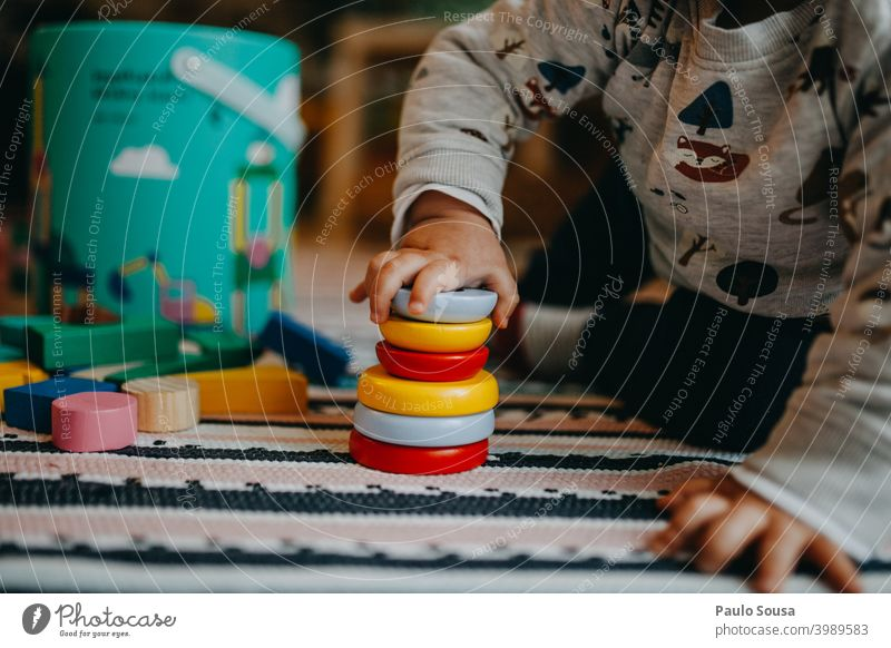 Toddler playing with wooden toy Toys Kindergarten Authentic at home Human being Joy Infancy Playing Child Happy Cute preschooler Action Creativity Multicoloured