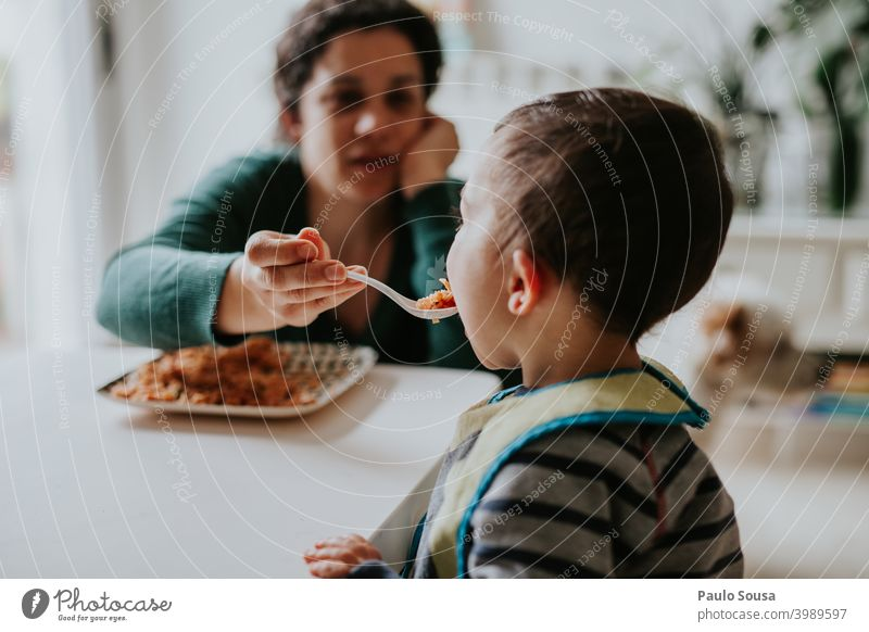 Mother feeding child motherhood Together togetherness Child care Caucasian Happiness people Infancy Woman Hold Joy Family & Relations Happy Lifestyle Love