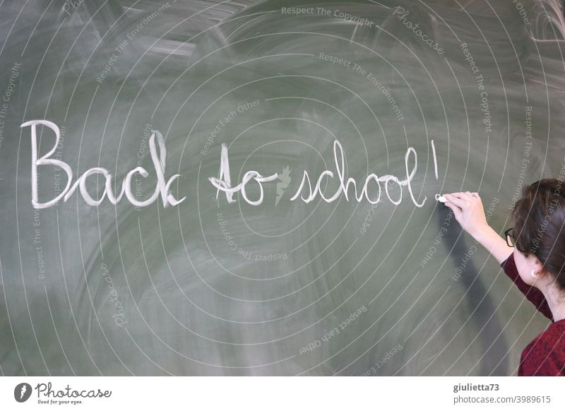 Back to school - Young teacher writes with chalk on the blackboard School Lessons back to school Classroom teaching Chalk Blackboard Teacher 18-25 years Day