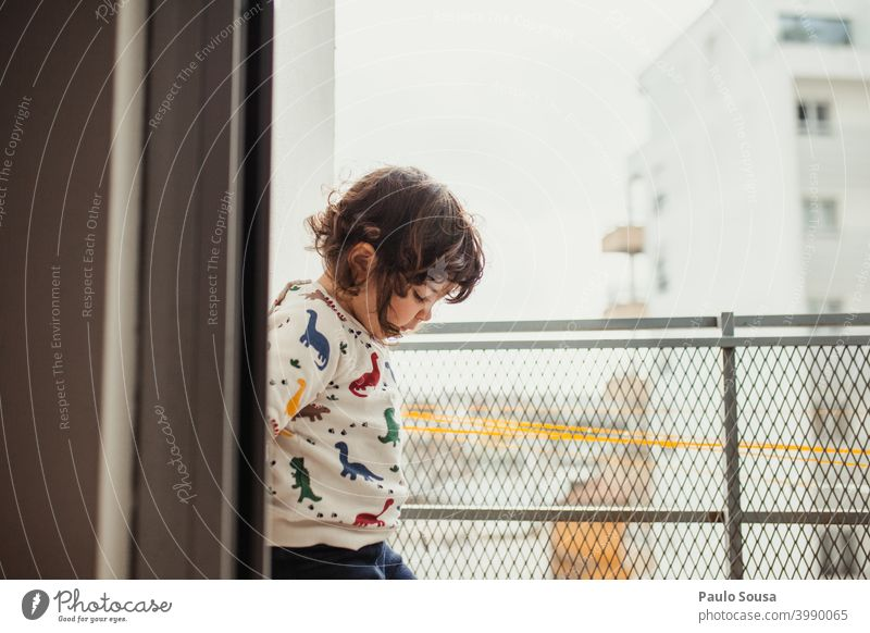 Cute little girl playing on the balcony Balcony Child childhood at home Day Quarantine stay at home Family & Relations Light Interest Colour photo Infancy