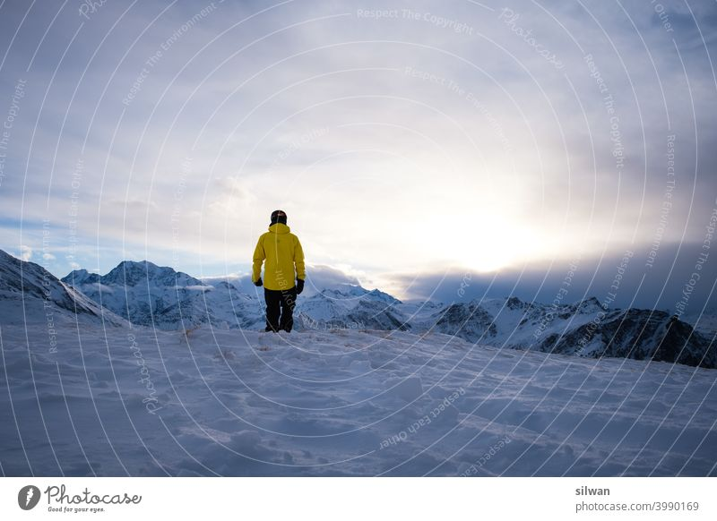 Valley view in the evening sunset mountainous Rock Switzerland Clouds in the sky person Yellow Snow Ice Frozen Influencer Snowboarding diffuse light