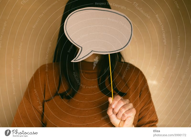 Have nothing to say and remain silent. Woman with empty speech bubble in front of her face. To be silent Speech bubble Empty have no say say nothing speechless