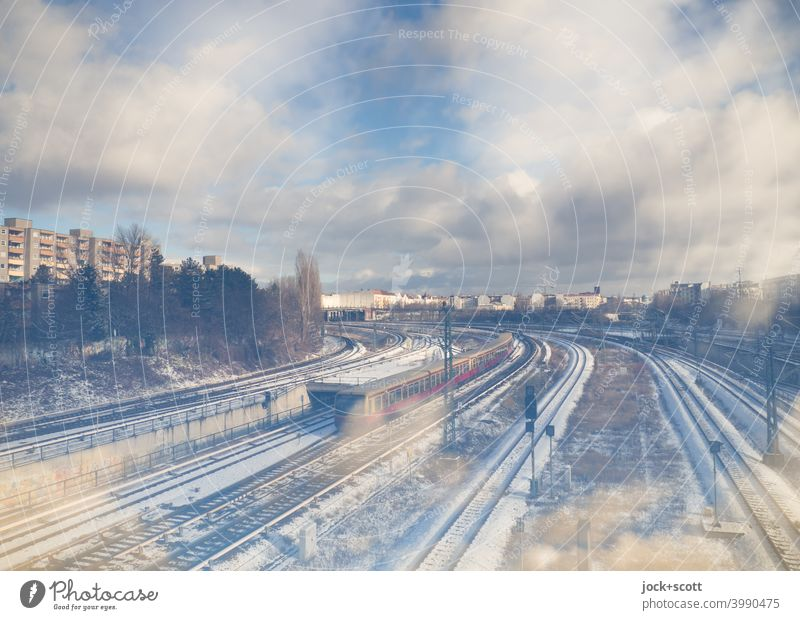 Northern cross with lots of snow and clouds Berlin-Wedding Commuter trains Rail transport Railroad tracks Double exposure Sky Clouds Public transit