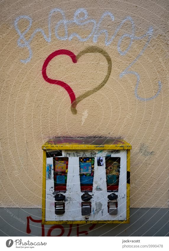 Love for neglected gumball machine Gumball machine Design Change Abrasion Ravages of time Weathered Street art Heart (symbol) Scrape Creativity Dirty Graffiti