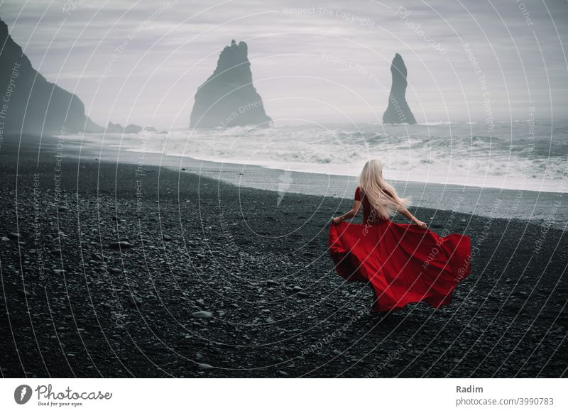 Reynisdrangar beach with red dressed woman Dressed dressed in red ocean Atlantic Elegant Clothing Style Human being Lifestyle Fashion Hip & trendy Model Suit
