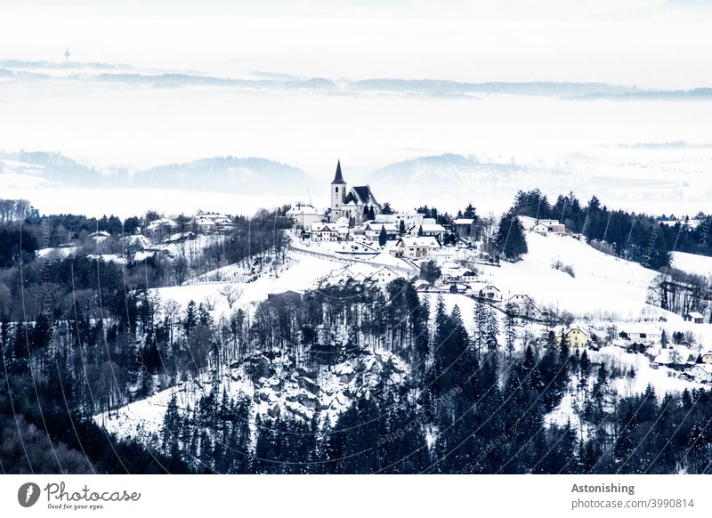 small, snow-covered village in a hilly landscape All Saints' Day in the Mühlkreis Landscape Nature location Village Church Church spire Austria mill district