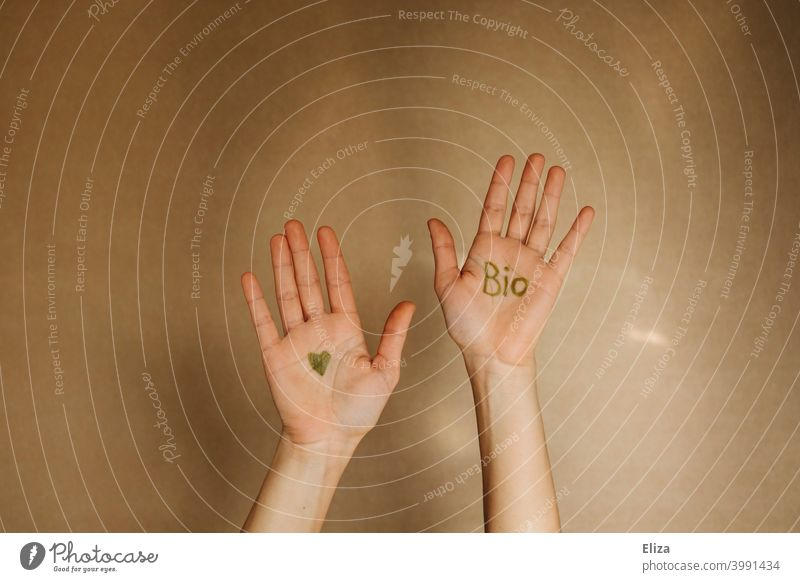 Hands with the word bio and a heart in green color organic Ecological Organic produce hands Sustainability salubriously Heart Nutrition Eco-friendly Biological