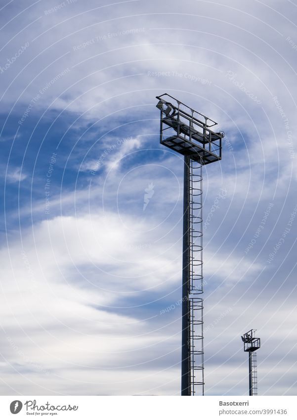 Lighting poles on the field in front of interesting sky Abstract Pole Colour photo Sky Deserted Day Blue Exterior shot Copy Space top Copy Space left Lamp
