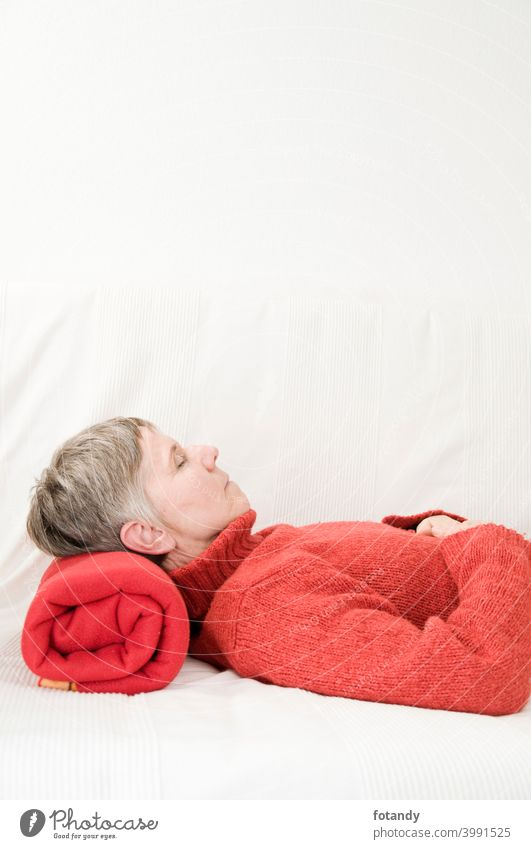 Relaxation in red vertical relax Woman Upper body older woman Satisfaction Adult peaceful Gray hair short hair cozy feel well lying on your back Person