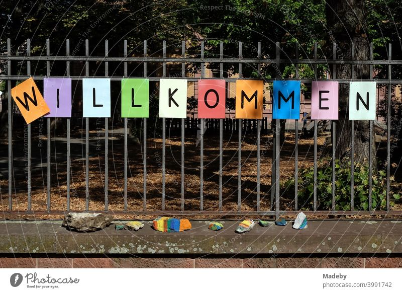 Lettering WELCOME made of black letters on coloured paper on the fence of a school after the summer holidays in the Nordend district of Frankfurt am Main in the German state of Hesse